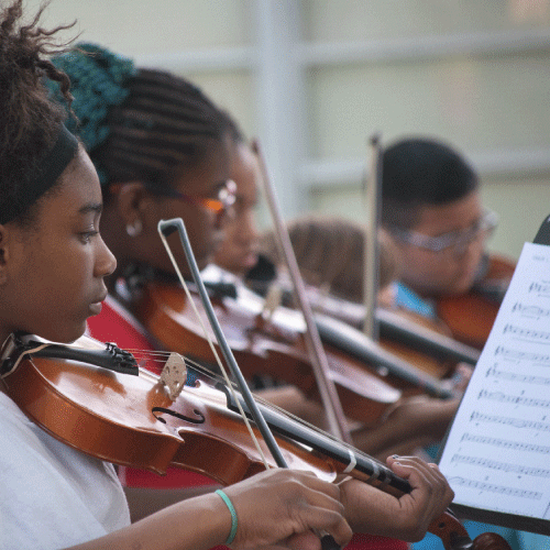 An image of students at Halls Ferry playing violin.