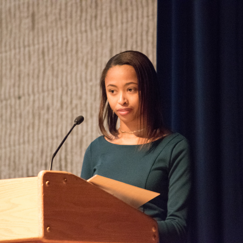 An image of McCluer North High School Student, Cheyenne Parson, speaking at a podium.