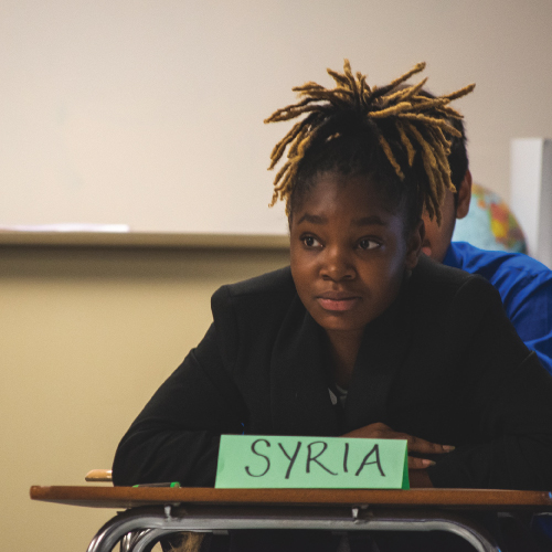 An image of a student representing Syria during the presentation.